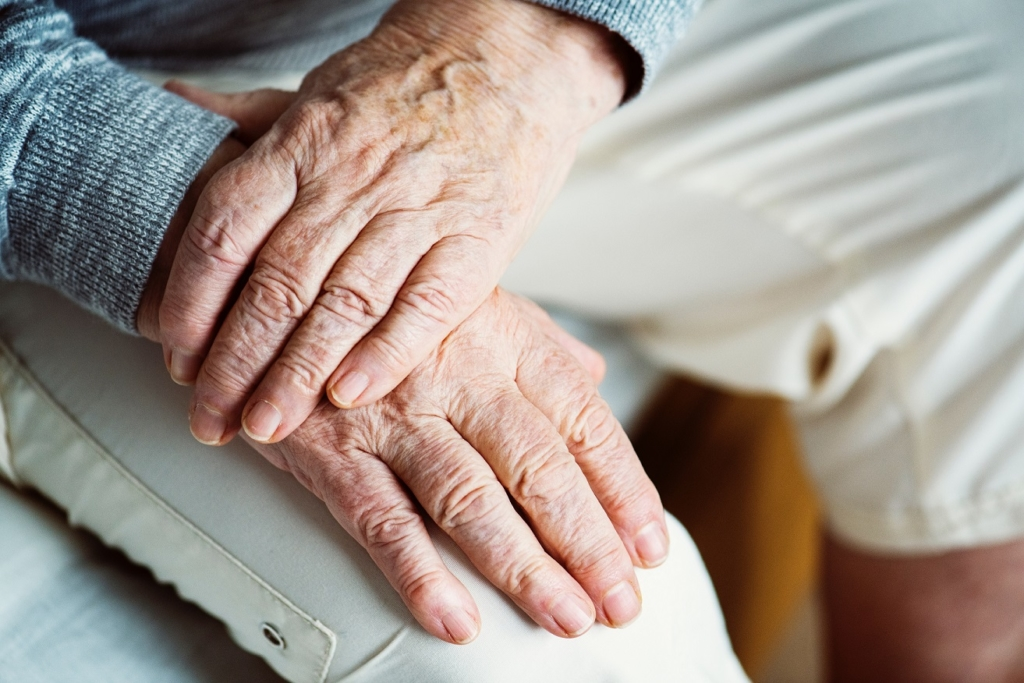 Aging Hand on top of another hand 1024x683 - Respite Care