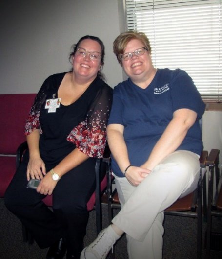 Photo of 2 happy staff members at Pleasant View Home in Inman, Kansas