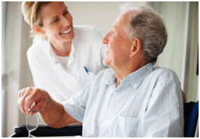 Photo of a skilled nurse assisting an elderly man with physical therapy